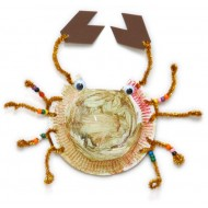 Use a color painted paper dish and add some parts to compose a crab